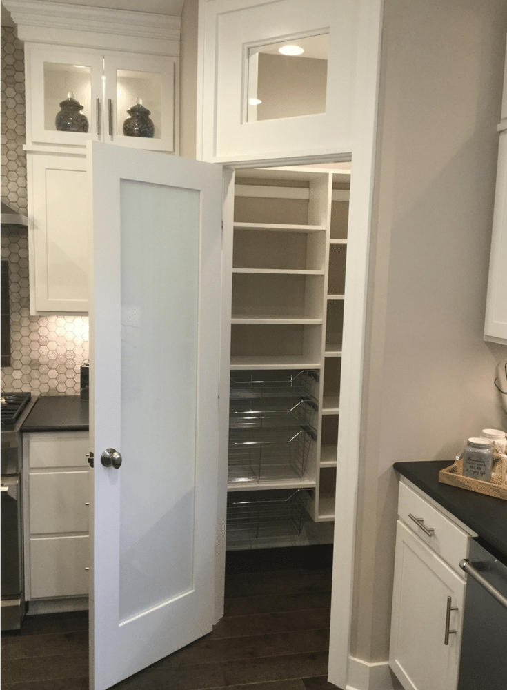 Sliding pantry storage baskets in a chrome finish for an easy to use custom pantry. This was displayed at the Columbus 2017 Building Industry Parade of Homes - Innovate Home Org