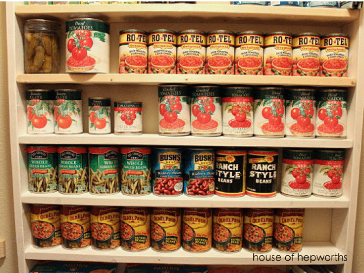 Canned goods on shelves in an organized pantry