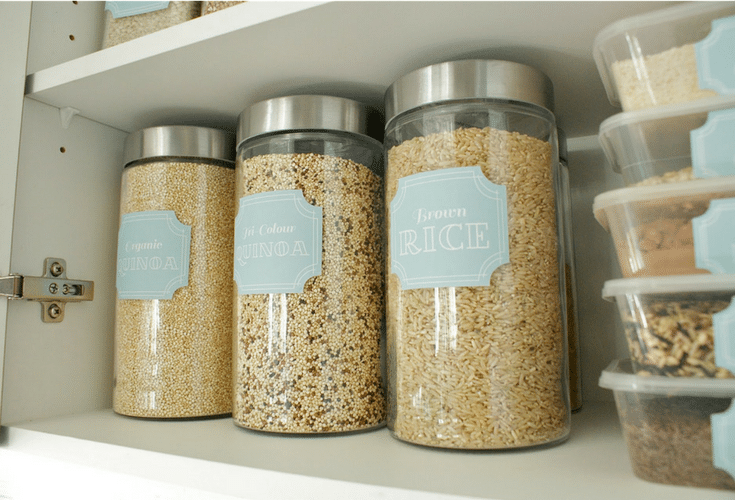 Clear containers for bulk goods in an organized kitchen pantry