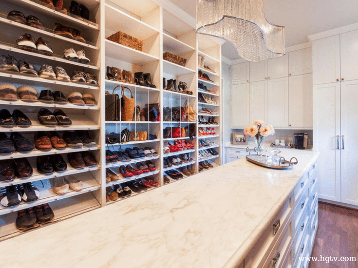 Angled and raised shoe shelves in a luxury custom closet | Innovate Home Org Columbus Ohio