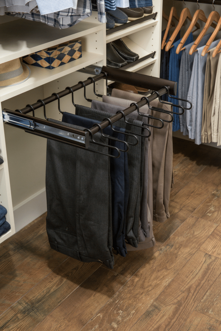 Pull out pants rack in a Columbus Ohio closet | Innovate Home Org | #PantsRack #ColumbusCloset #ClothesStorage #HangingOrganizer