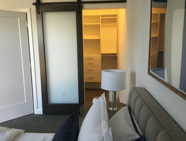 Sliding barn door for accesible closet | Innovate Home Org | #AccessibleCloset #ClosetDoor #SlidingBarnDoor