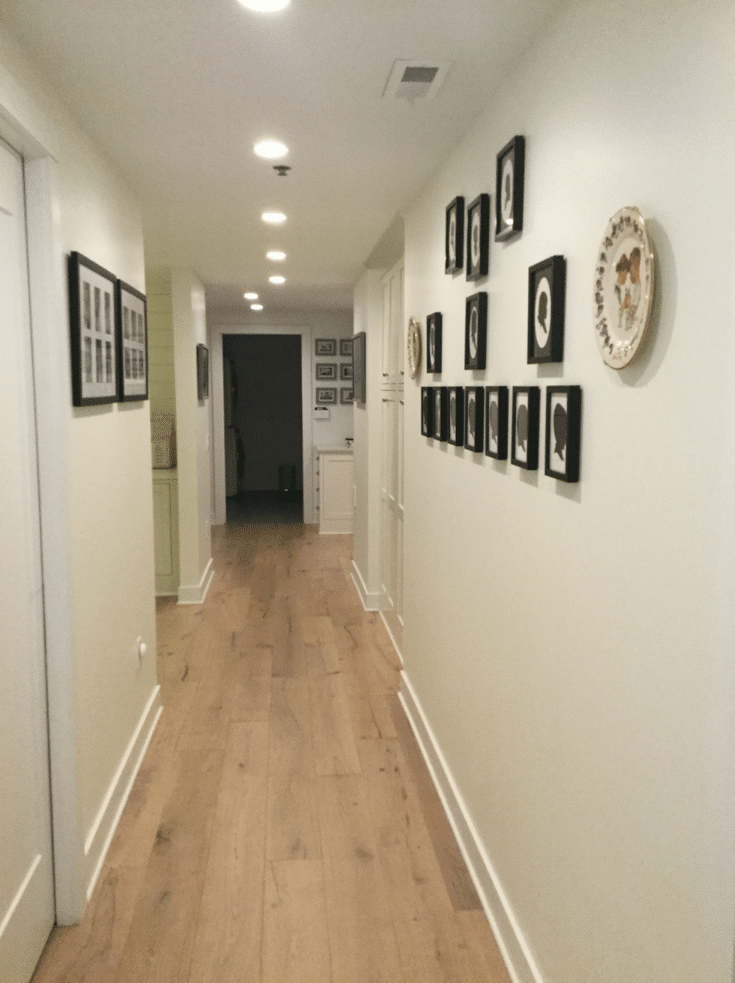 Consistent light beige walls with black framed photos | Innovate Home Org | Dublin Home | #SimpleHome #DreamHome #Hallways
