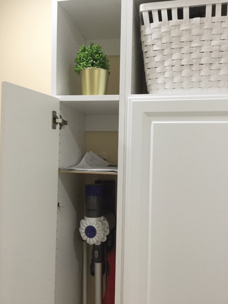 Narrow cabinet with Dyson vaccuum in a bexley mudroom | Innovate Home Org | #NarrowCabinets #ClosedCubbies #EntryWayStorage