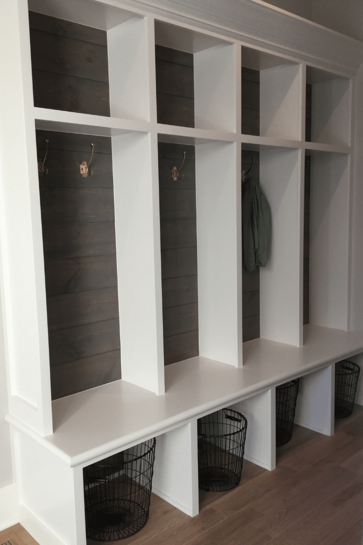 Gray wood feature wall in open cubby mudroom Memmer Homes | Innovate Home Org | #OpenCubby #MudroomStorage #FeatureWall