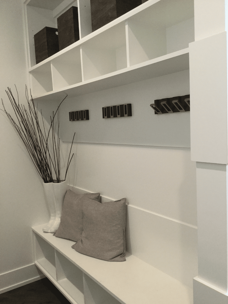 Minimalist contemporary mudroom storage hooks in Romanelli and Hughes home | Innovate Home Org | #MudroomStorage #ContemporaryMudroom #StorageHooks