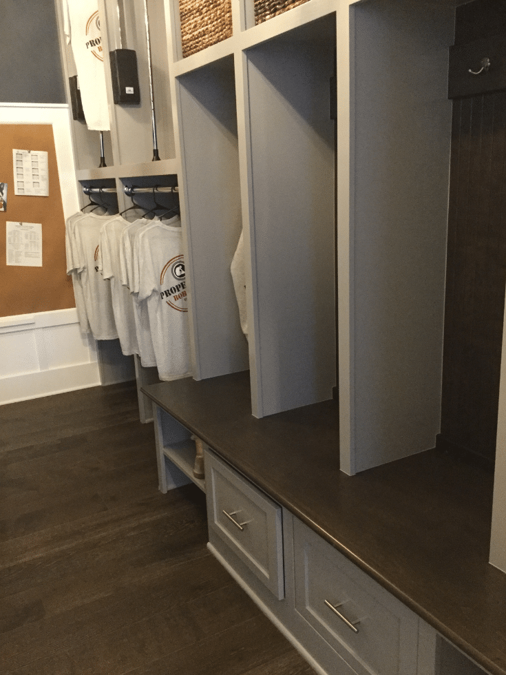 Pull out drawers in Bob Webb mudroom cabinetry | Innovate Home Org | #MudroomCabinetry #MudroomStorage #EntryWayStorage