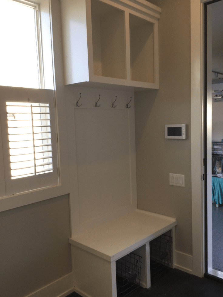 Small mudroom open cubby system in a Parade home | Innovate Home Org | #SmallMudroom #OpenCubbies #MudroomOptions