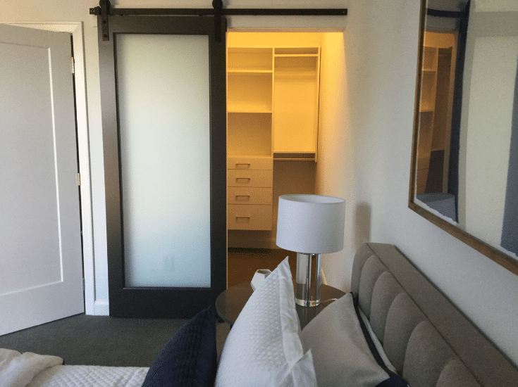 Sliding barn door in a custom closet in Columbus ohio | Innovate Home Org | #SlidingBarnDoor #CustomCloset #DublinClosets #WalkInCloset