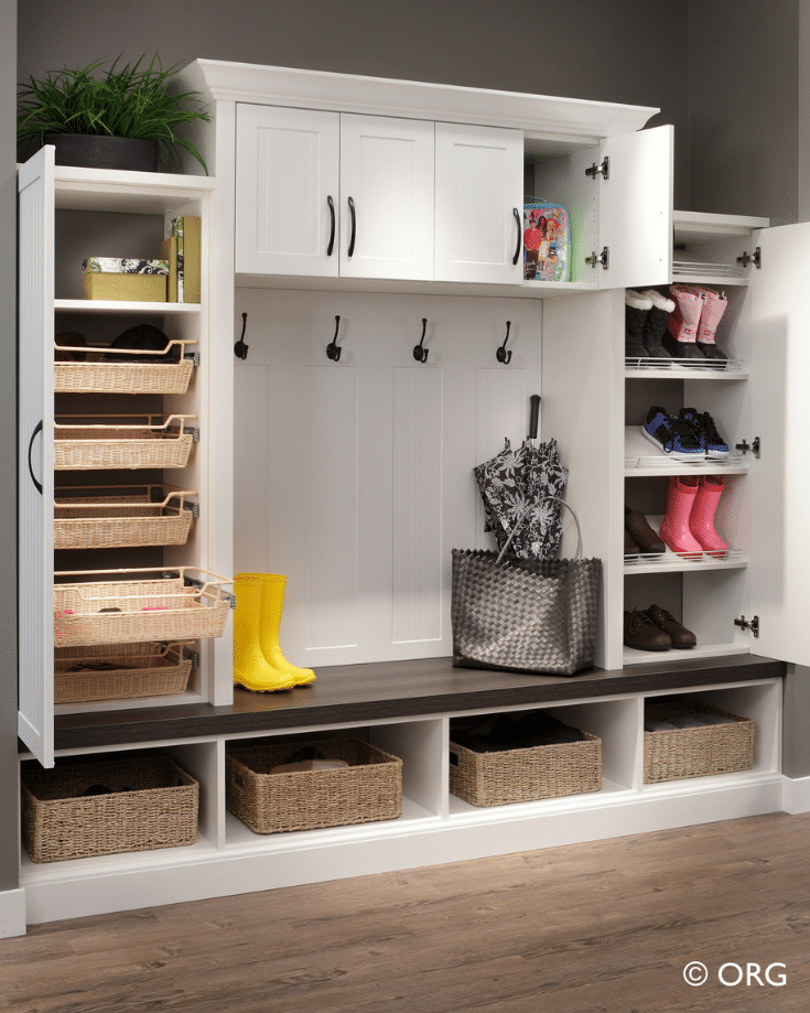 A laminate closet designed to withstand wet boots and clothes | Innovate Home Org | Upper Arlington, Oh | #ClosetCubbies #EntrywayDesigns #MudroomIdeas #OrganizationIdeas