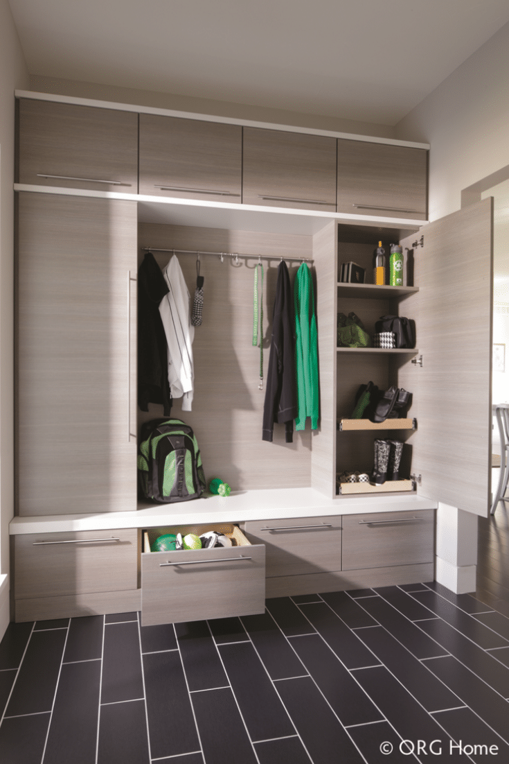 Separate doors for storage in a custom mudroom | Innovate Home Org | Columbus, OH | #ClosetCubbies #BenchSeating #StorageTips #OrganizationIdeas