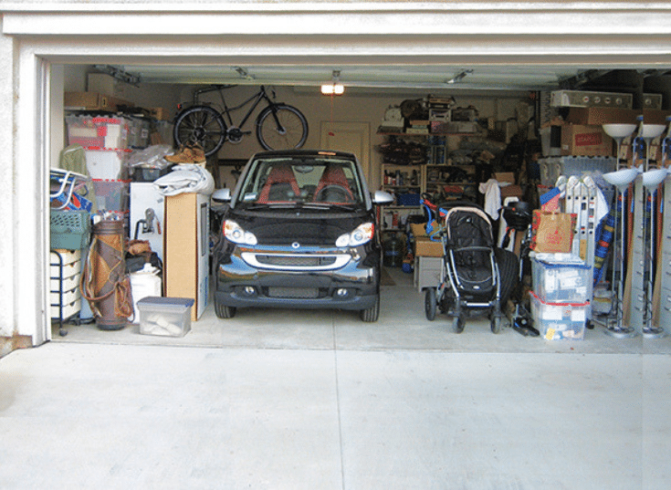 A garage with too much stuff Consumer Reports | Innovate Building Solutions | Innovate Home Org | #MessyGarage #ClutteredGarage #OrganizationHelp #HowToOrganize