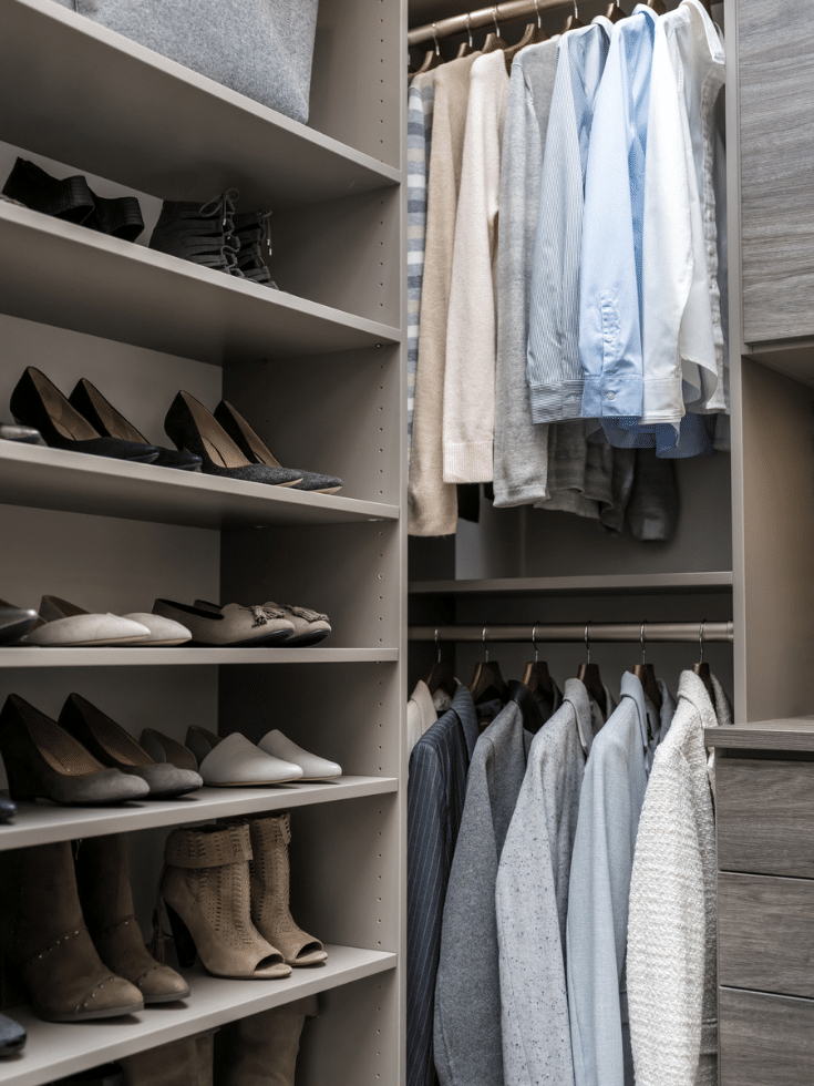 Flat shoe shelves in a Columbus closet | Innovate Home Org | #ShoeShelves #CustomCloset #HangingStorage #ShoeRacks