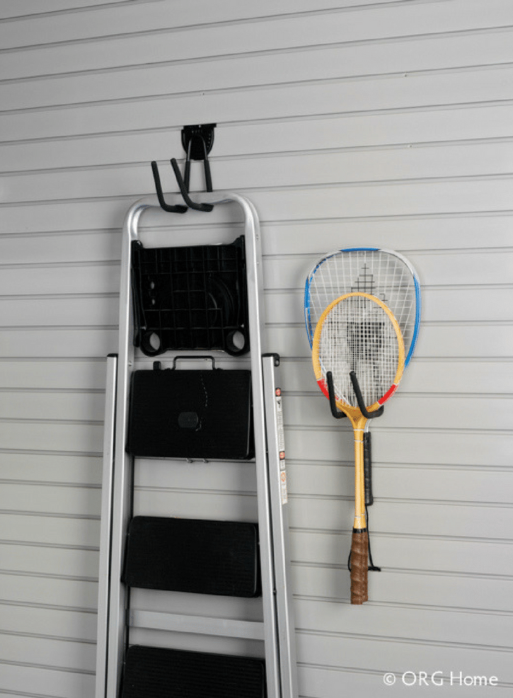 Organization slat wall and pegboard system for ladder and sporting equipment storage Columbus Ohio | Innovate Building Solutions | Innovate Home Org | #OrganizationSystem #SlatWall #StorageRacks #StorageHooks