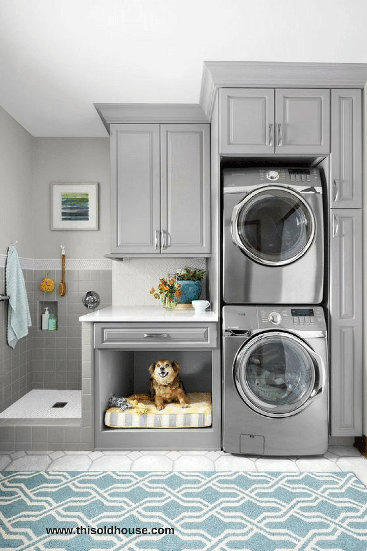 Combined mudroom laundry room cabinetry storage with a pet seating area | Innovate Home Org | Columbus OH | #StorageSystem #MundroomStorage #LaundryRoom