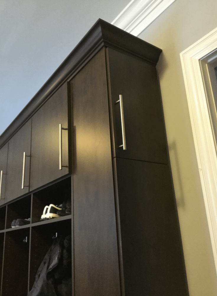Mocha colored laminate mudroom storage system in Dublin Ohio | Innovate Home Org | Columbus OH | #HomeOrganization #OrganizationSystem #StorageSystem