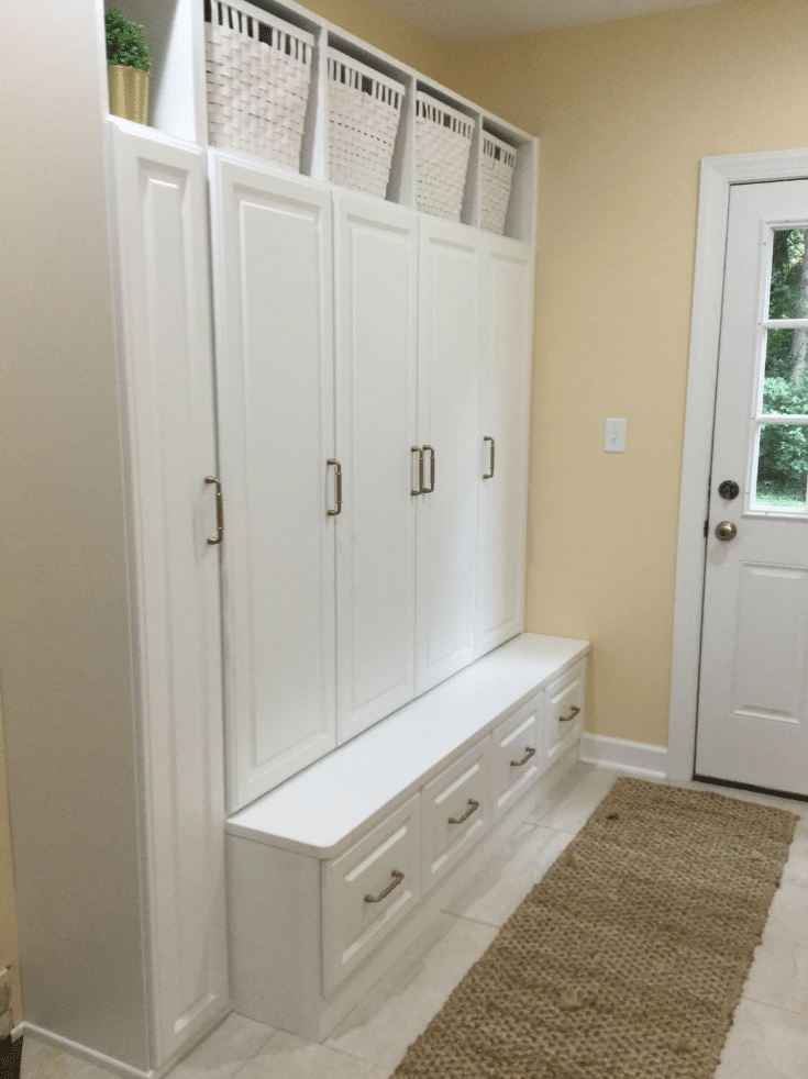 White Laminate mudroom system Bexley Ohio | Innovate Home Org | Columbus OH | #MudroomStorage #ClosedStorage #Entryway #WhiteMudroom