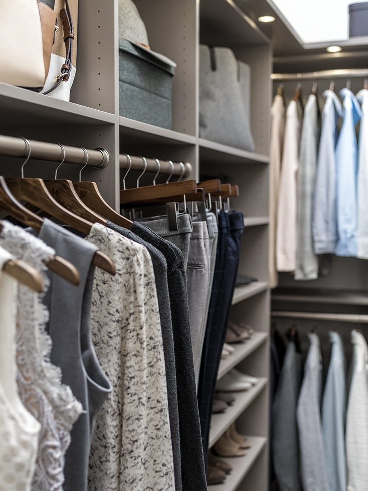 using shelving and hanging for an efficient closet corner design | Innovate Building Solutions | Innovate Home Org | Columbus, OH | #ClosetStorage #HangingStorage #WalkInCloset