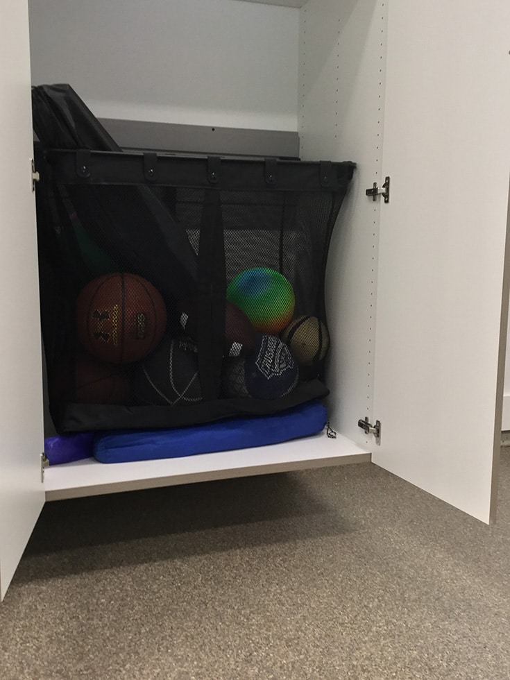 Garage storage mesh basket for balls in New Albany Ohio garage | Innovate Home Org | #GarageStorage #Meshbasket #NewAlbanyGarage
