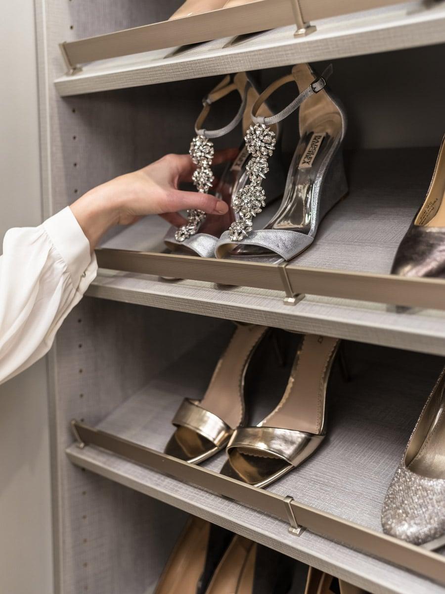 slanted shoe shelves in a custom Columbus Ohio closet | Innovate Home Org | #CustomShelving #ClosetShelving #SlantedShoeShelf