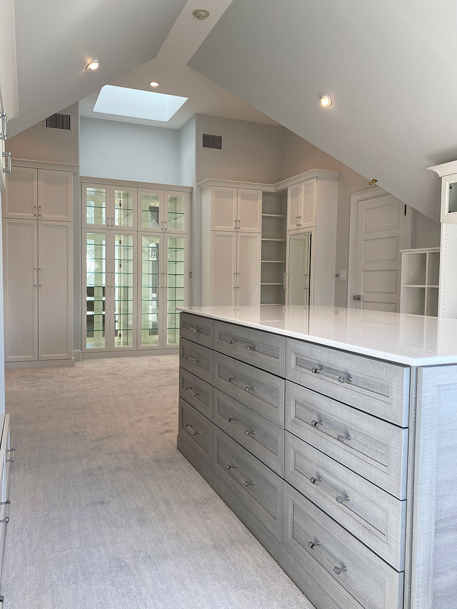 ceiling height in a custom closet credit Boutique Closets and Cabinetry | Innovate Home Org | Columbus, OH #CustomStorage #HighCeilings #CustomClosets