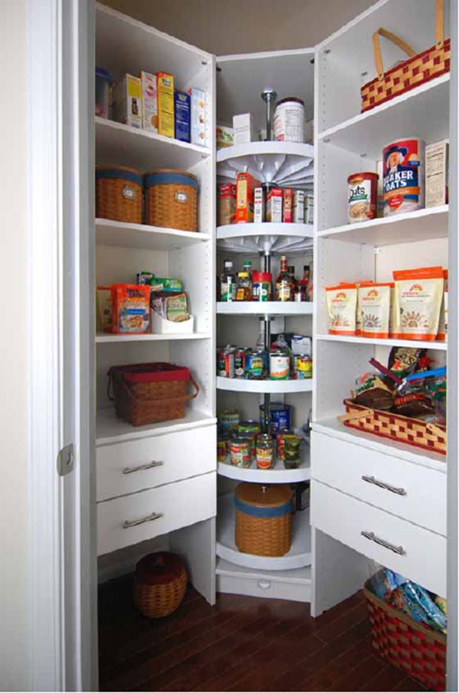 Custom lazy susan in a kitchen pantry credit Closet America.com | Innovate Home Org | #StorageSystems #OrganizationStorage #KitchenPantry #ClosetStorage