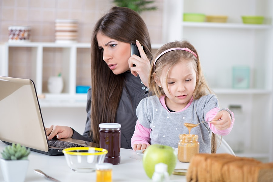 Frustrated mom work at home kid interrupting at kitchen table | Innovate Building Solutions | Innovate Home Org | #WorkFromHome #OfficeSpace #Working #HomeOffice