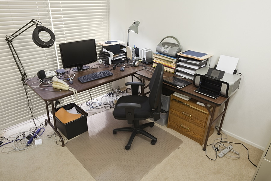 messy extension cords in a home office | innovate building solutions  Innovate Home Org | Columbus Home Office  | #HomeOffice #MessyOffice #OrganizaeOffice