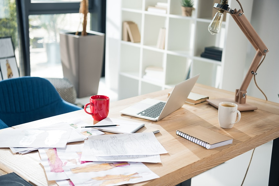 messy papers on a desk is bad for small workspaces | Innovate Building Solutions | Innovate Home Org | #MessyWork #WorkSpace #homeoffice