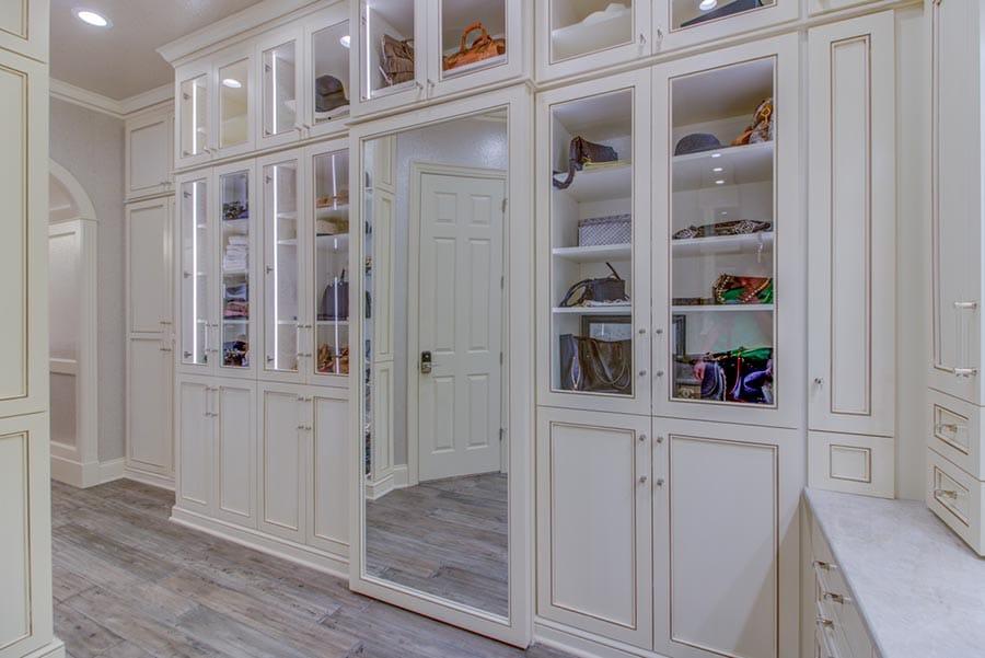 Idea 1 glass doors in a cleveland custom closet credit Beth Patrick Closet Factory Cleveland | Innovate Home Org | Columbus, OH | #ClosetOrganization #CustomStorage #ClosetStorage