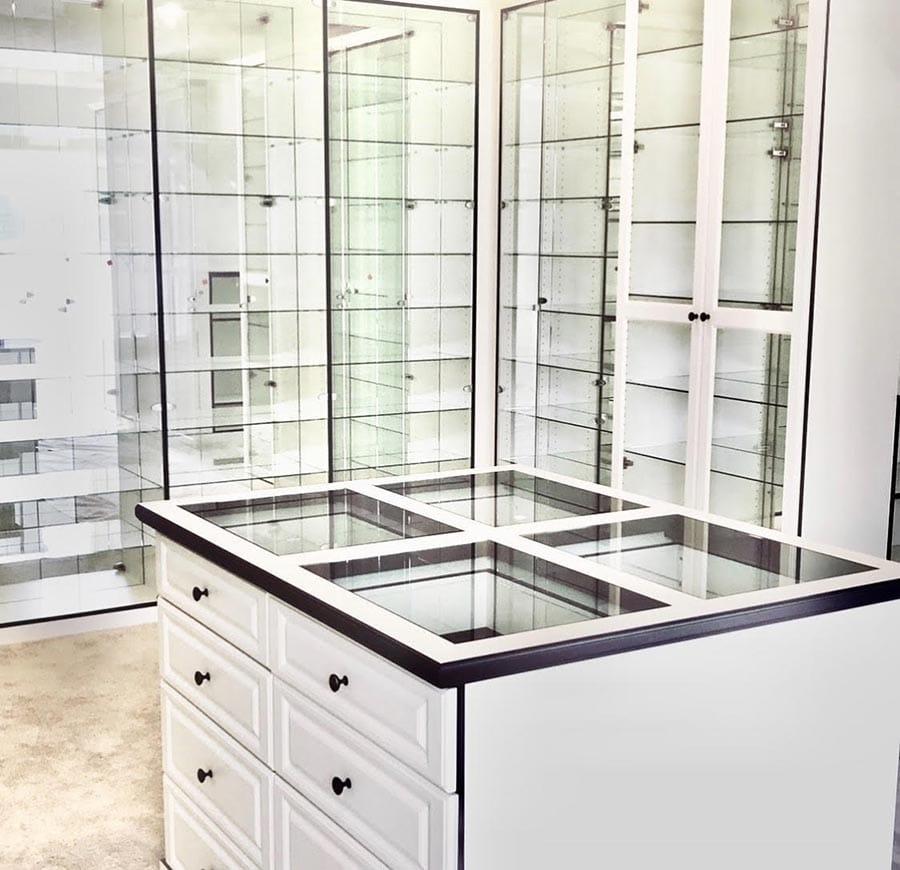 Idea 16 glass shelves in a custom closet and island credit Beth Patrick Closet Factory Cleveland | Innovate Home Org | #GlassShelves #StorageShelves #Organization #BeautifulClosets