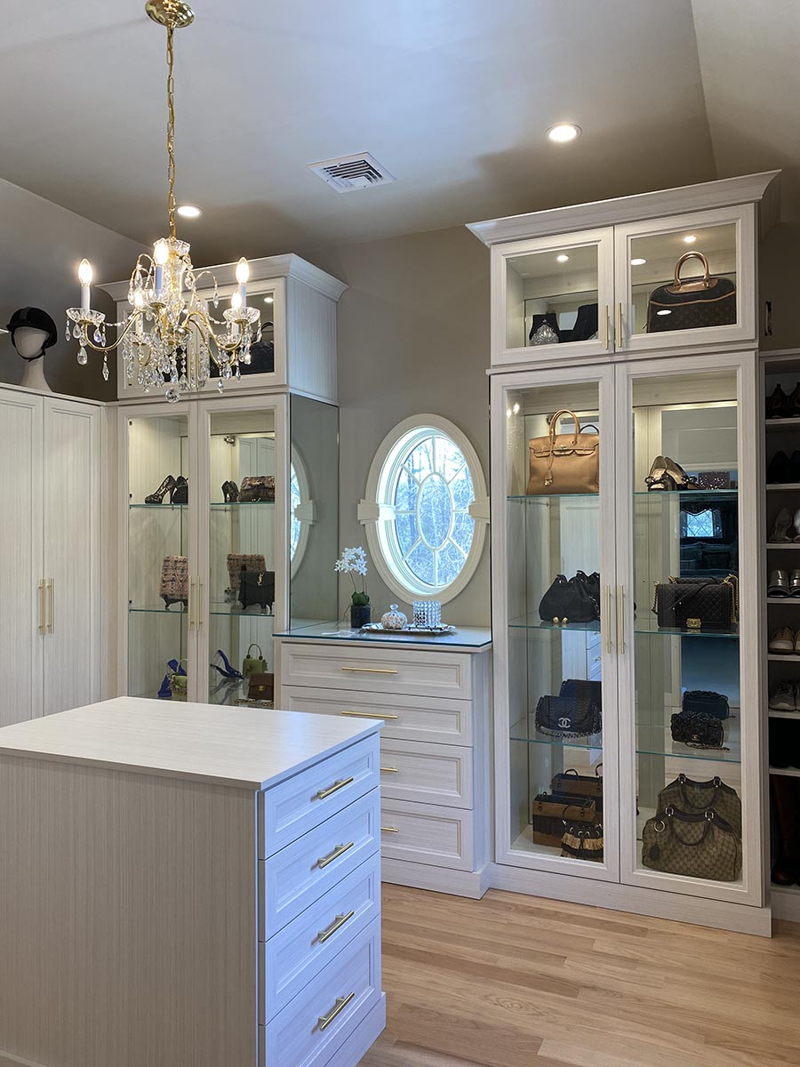 Idea 2 a feature closet wall with glass doors mirrored backs credit Patty Miller Boutique Closets and Cabinetry | Innovate Home Org | Columbus, OH Dublin, OH | #CustomStorage #HomeOrganization #beautifulclosets #DesignerCloset