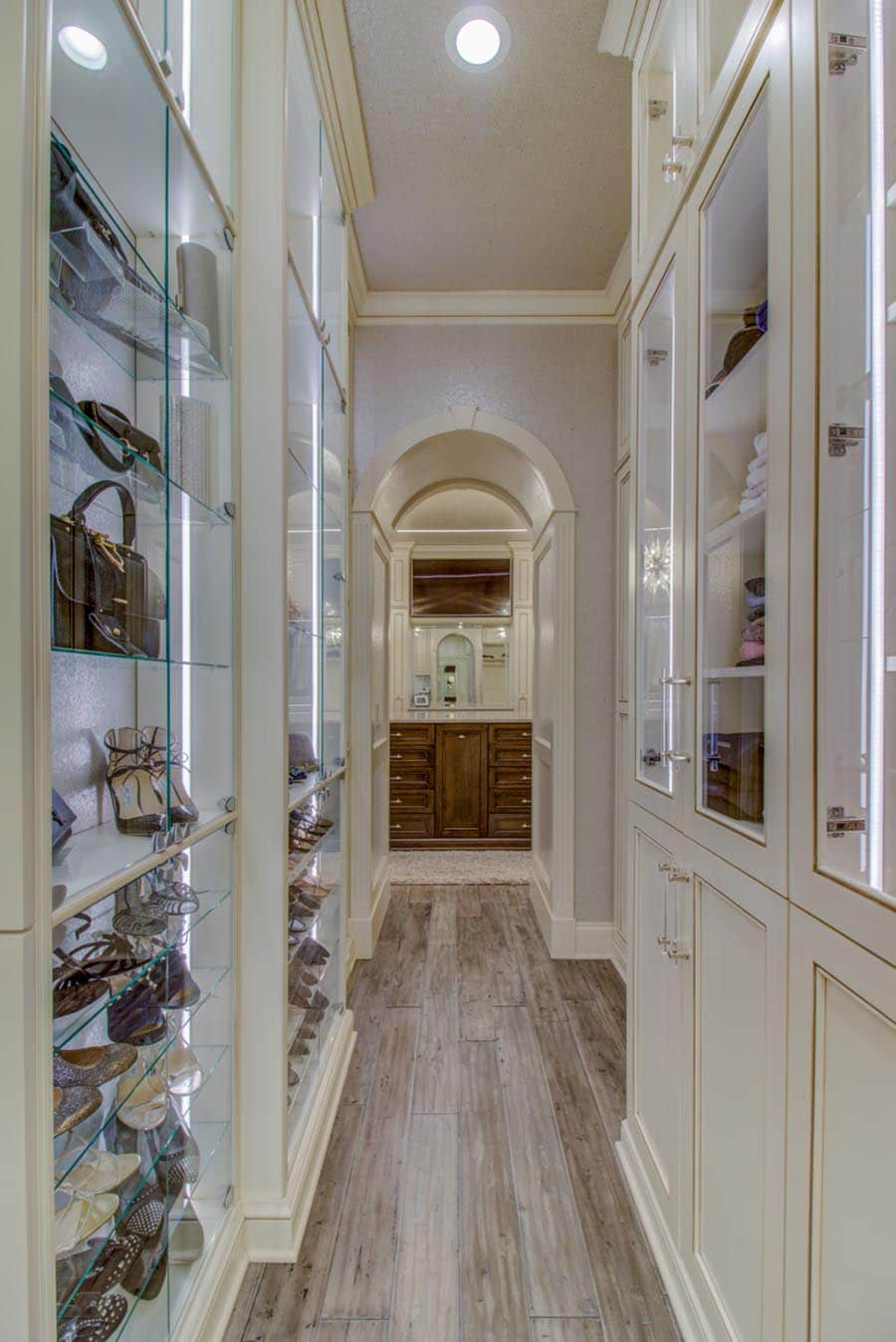 Idea 9 lighting in a luxury high end closet credit Beth Patrick Closet Factory Cleveland | Innovate Home Org  | #customstorage #OrganizationSystems #StorageSolutions