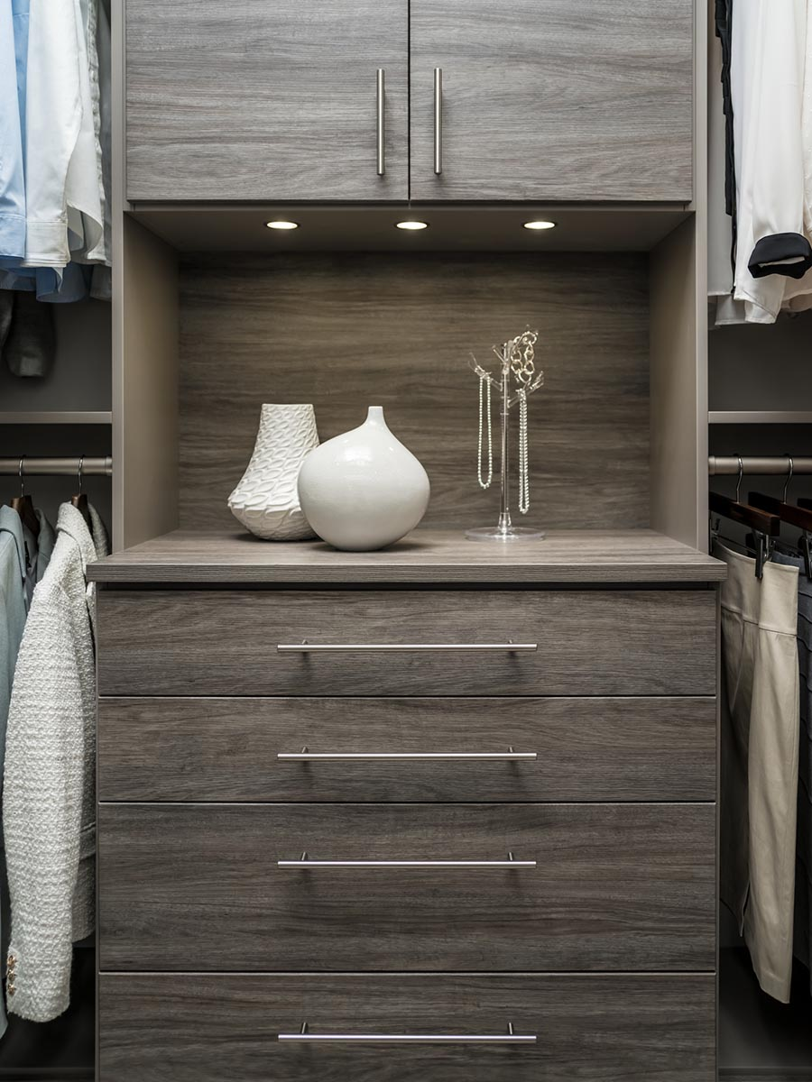 Pro 3 focal point in a closet system drawers with a custom back panel | Innovate Home Org | #Closetdesign #customstorage #walkincloset
