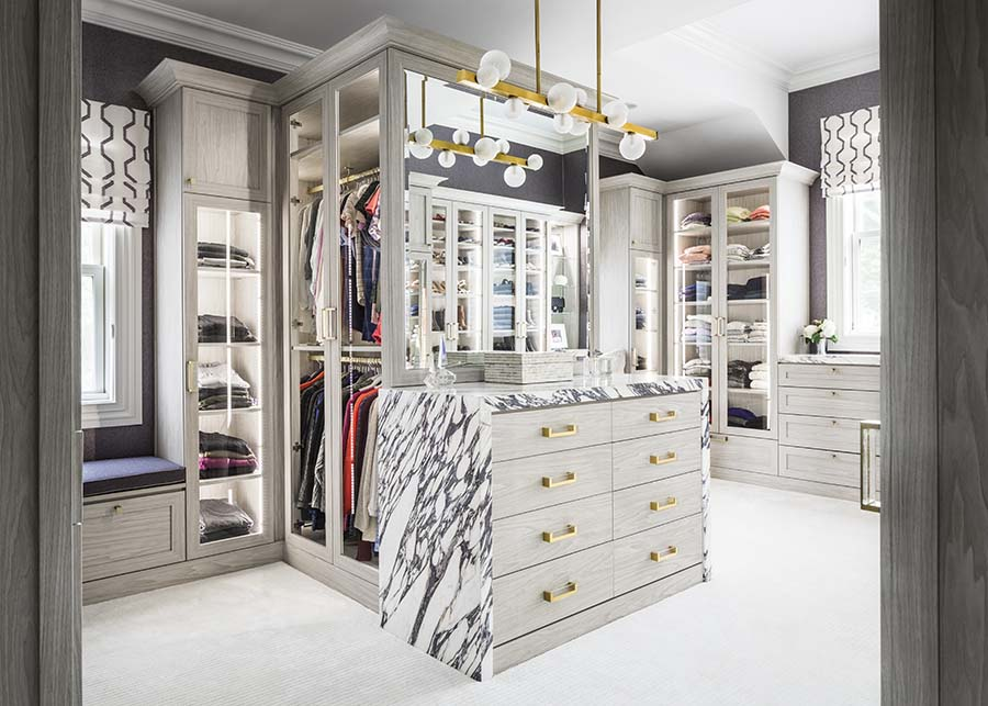Trick 5 high end luxury closet with glass doors with shoes handbags credit Patty Miller Boutique Closets and Cabinetry | Innovate Home Org #CustomStorage #LuxuryCloset #OrganizationSolutions
