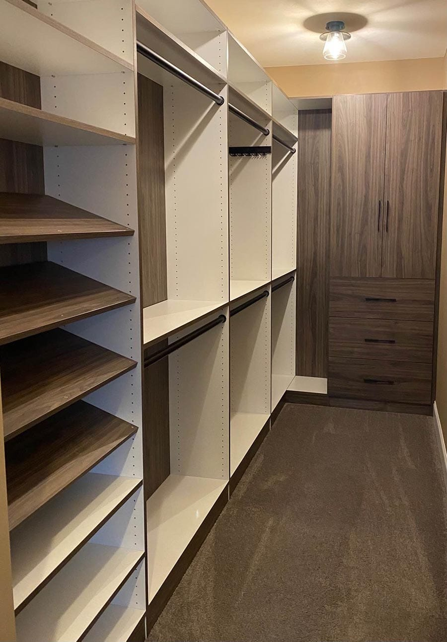 Trick 6 back panels which contrast with a white laminate custom closet credit Jessice Behnke | Innovate Home Org #CustomStorage #BackPanels #WalkInCloset #DesignerCloset