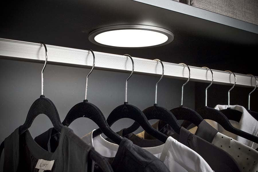 Strategy 7 - thin velvet hangers more room small walk in closet columbus | Innovate Home Org #CustomStorage #VelverHangers #StorageOrganization
