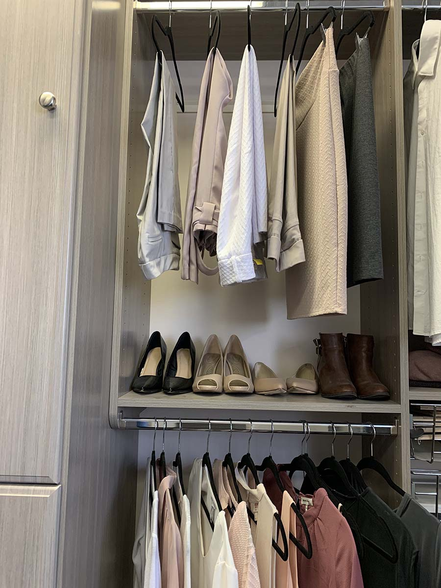 Strategy 8 pants on the top shirts on bottom double hang strategy columbus | Innovate Home Org #StorageOrganizaiton #Organization #HomeOrganization