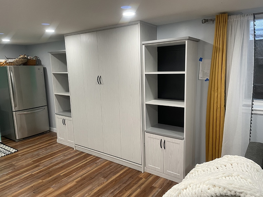 Reason 2 vertical murphy bed adds volume to this Columbus Westerville basement   Innovate Home Org   Columbus, OH #downtowncolumbus #VerticalMurphyBed #WallBed #Guestroom #Studio